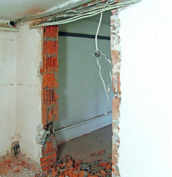 Création d'une ouverture dans le mur par demolition